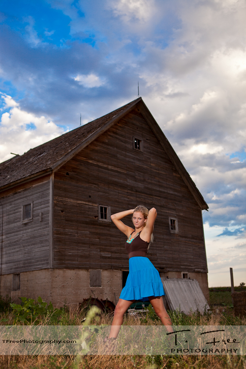 Excellent blue sky senior picture with old barn in western Nebraska.
