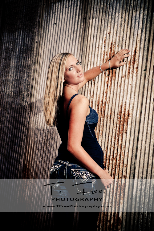 Beautiful stunning senior picture in a grungy alley in Omaha Nebraska.