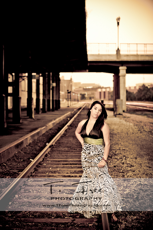 Outdoor glamour prom dress senior pictures at the downtown Omaha train station at sunset.