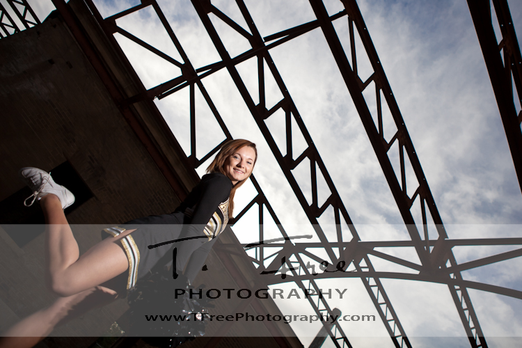 High school senior varsity cheerleader picture taken in downtown omaha nebraska.