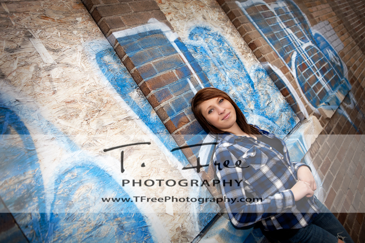 Outdoor grunge graffiti senior picture in north downtown Omaha Nebraska.