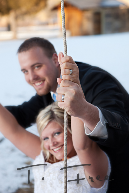 Sylvan Dale swing with bride and groom showing their wedding rings.