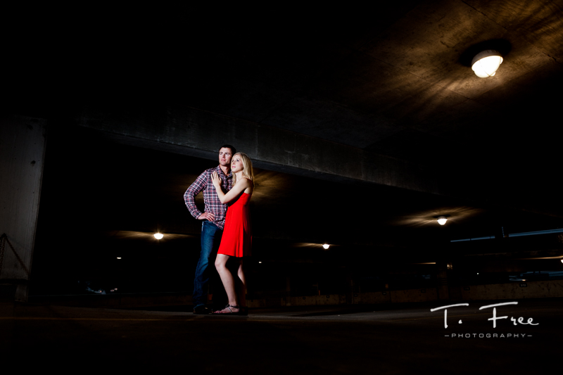 Dramatic outdoor night parking garage engagement session.
