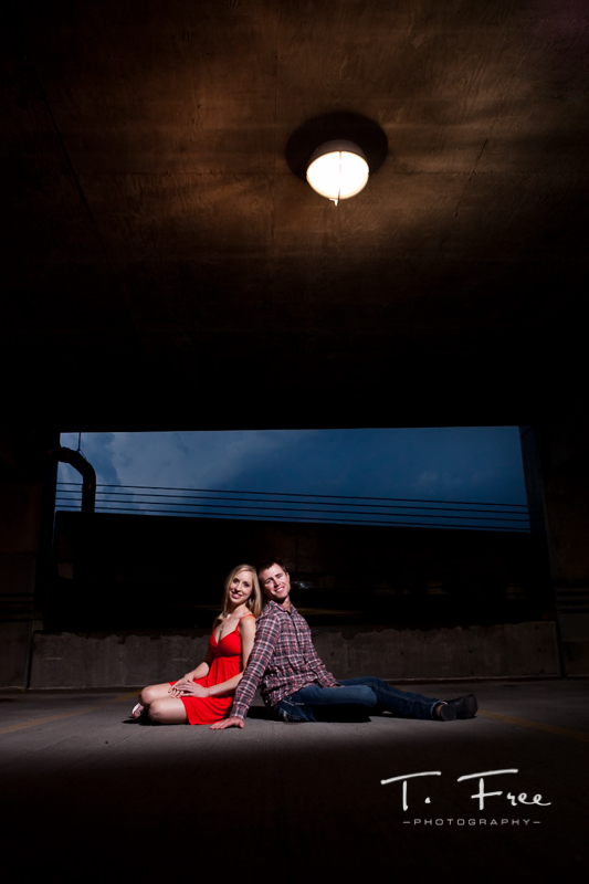 Dramatic parking garage radiopopper lighting used on Omaha Nebraska engagement picture.