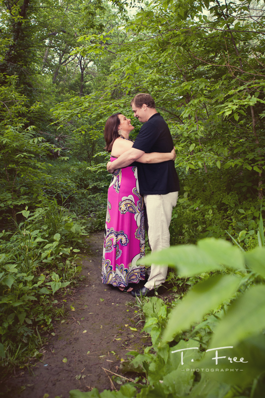 Lush green outdoor engagement picture at Elmwood Park near UNO in Omaha.