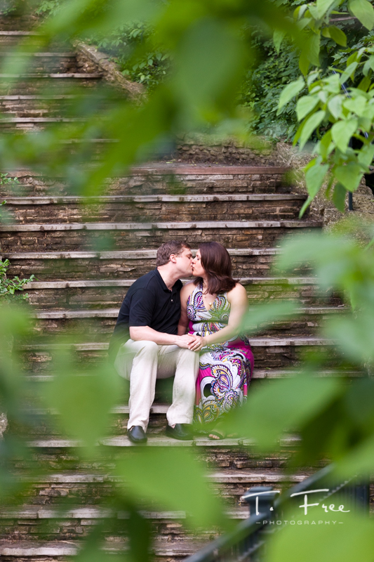 Beautifully framed outdoor engagement photo at elmwood park grotto in omaha nebraska.