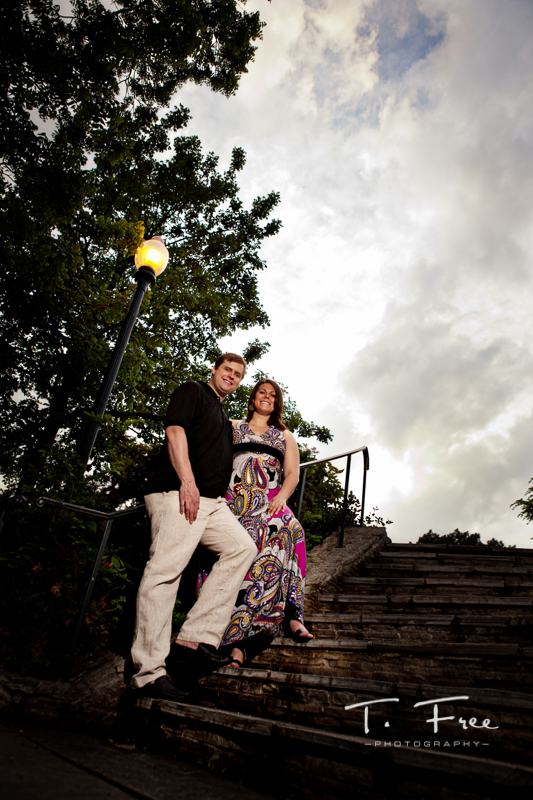 Dramatic sky wide angle unique outdoor engagement pictures at elmwood park grotto.