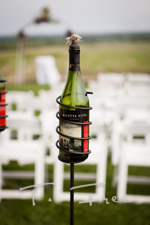 Brilliant wine bottle candle idea for outdoor vineyard wedding.