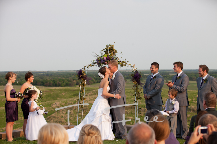 Newly married couple's first kiss taken near Omaha.
