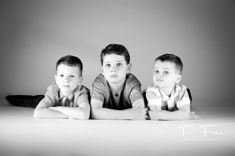 Black and white beautiful image of three boys from Gretna, Nebraska.