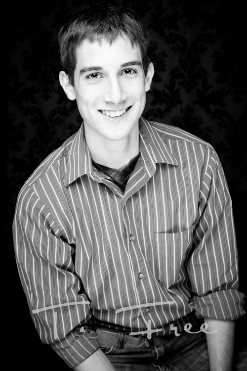 Neat black and white indoor studio picture of high chool senior guy from Elkhorn Nebraska.