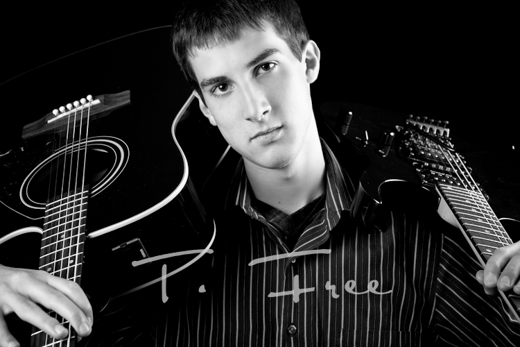 Killer black and white image of high school senior musician with his acoustic and electric guitars on his shoulders taken in Elkhorn, NE.