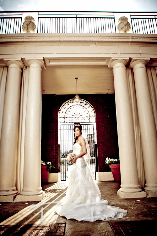Amazing HDR style image of vietnamese bride and very cool Roman columns at the Omaha Magnolia Hotel courtyard.