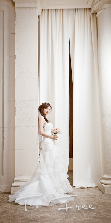 Stunning bridal image with the large outdoor courtyard curtains at the Omaha Magnolia Hotel.