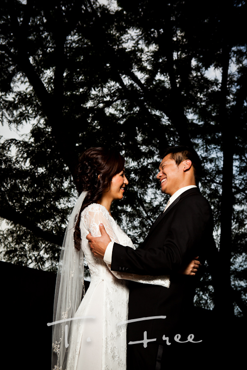 Natural smile image of bride and groom taken by vietnamese wedding photographer.