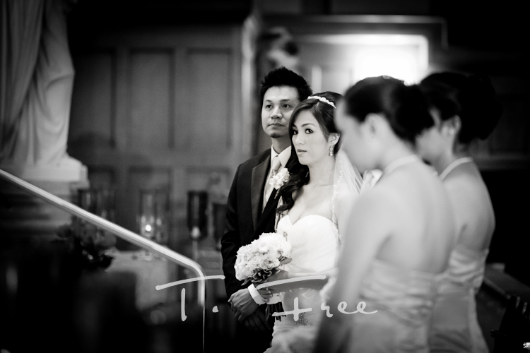Stunning black and white image of bride and groom at the alter in omaha.