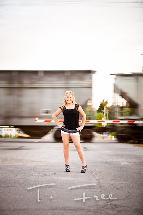 Cool outdoor senior girl picture with a train moving behind her near downtown Elkhorn, Nebraska.