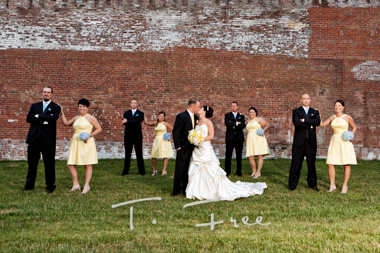 Wedding party outside in downtown Omaha for group wedding photos.