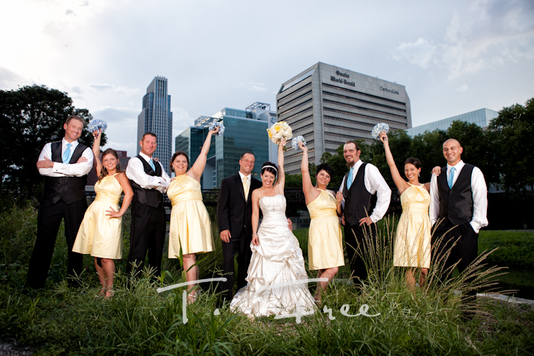Wedding party having fun during their photo shoot in Omaha.