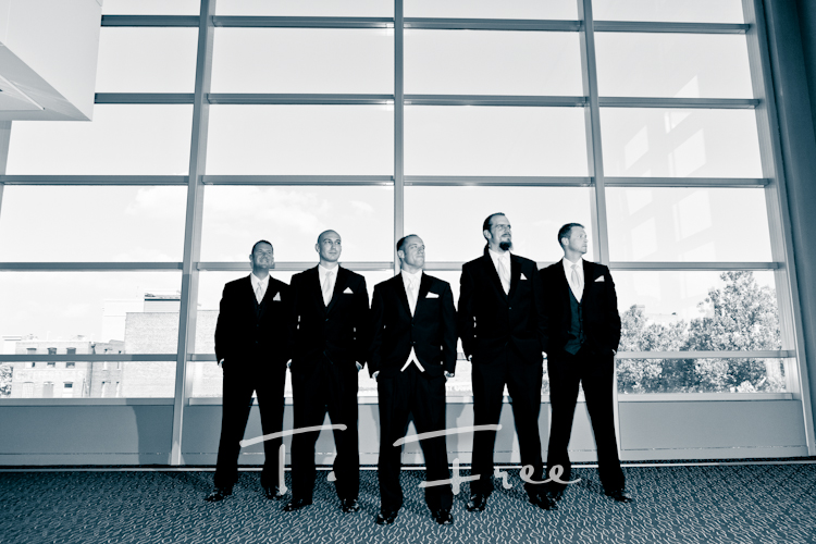Groom with his rowdy groomsmen at the Holland Performing Arts Center in downtown Omaha Nebraska.