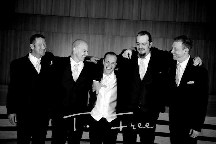 Groomsmen goofing around during formal pictures at the Holland in downtown Omaha Nebraska.
