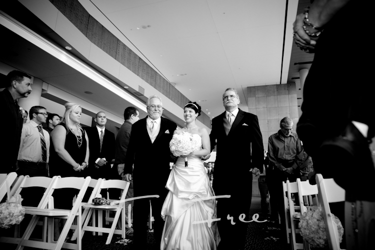 Bride walking down the aisle at the Holland Performing Arts Center in downtown Omaha Nebraska.