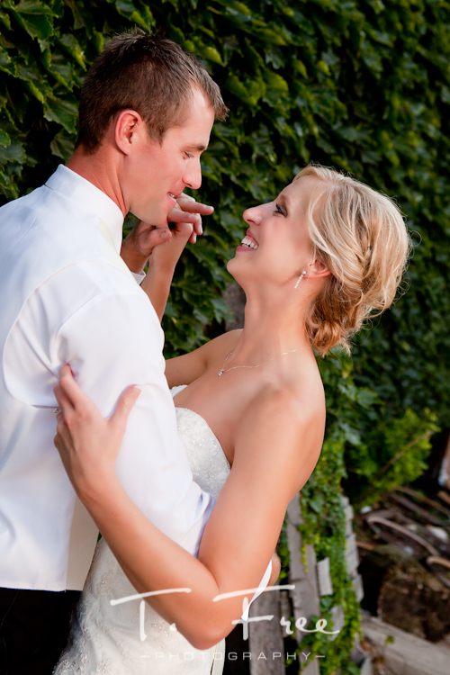 Natural moment between the bride and groom on their wedding day urban photo shoot in downtown Holdrege Nebraska.