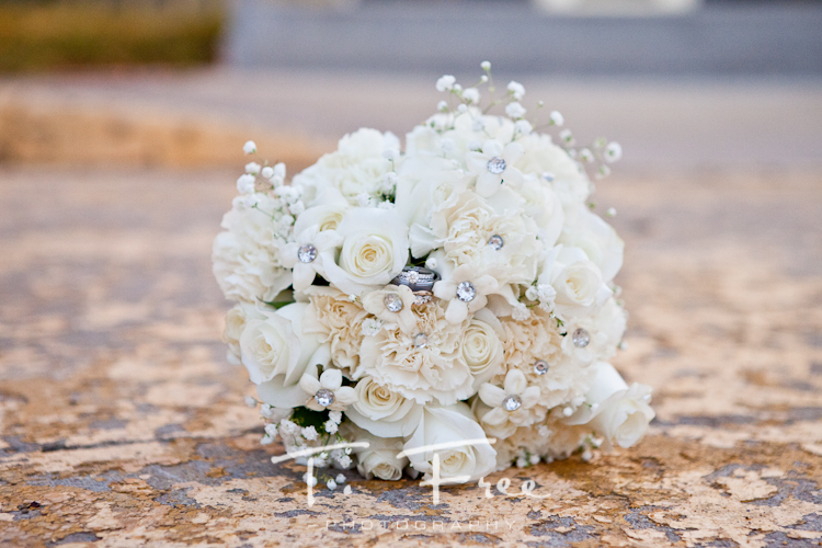 Beautiful shot of the bride's bouquet with their wedding rings.