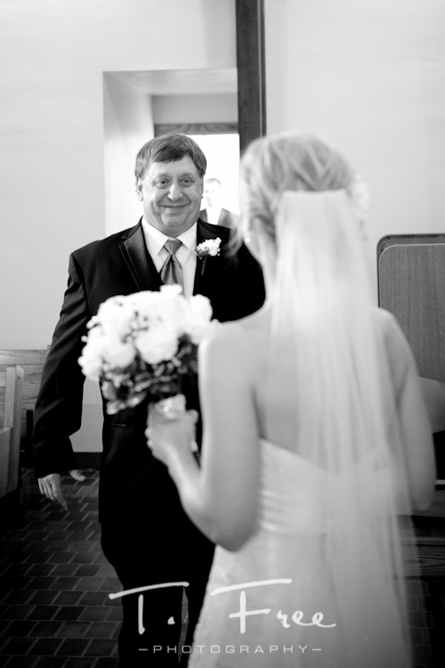 Emotional father seeing his daughter for the first time on her wedding day taken in Holdrege, Nebraska.