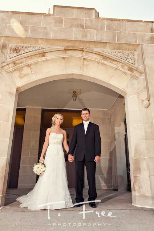 Stunning image taken of bride and groom in front of the church on their wedding day near Kearney Nebraska.