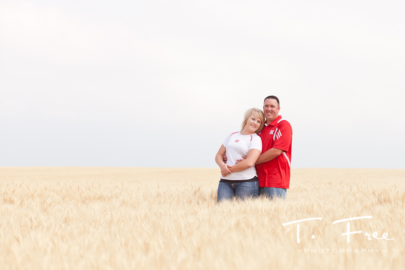 Engagement photo taken in a central nebraska wheat field.
