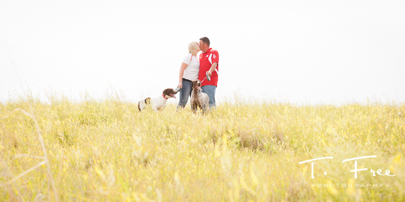 Couple kissing in Nebraska engagement photo.