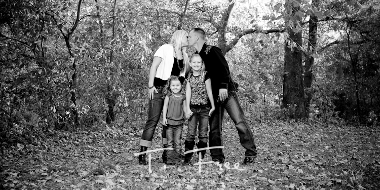 Outdoor black and white family portrait.