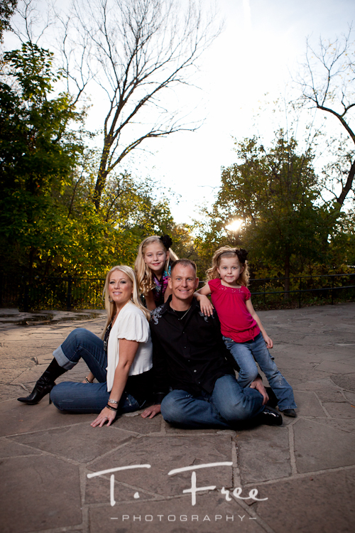 Outdoor fall family picture at sunset taken in Elmwood Park in Omaha.