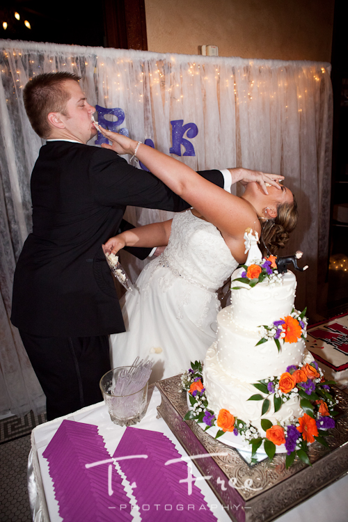 Bride and groom wedding reception cake smash at Cheex in Holdrege Nebraska.