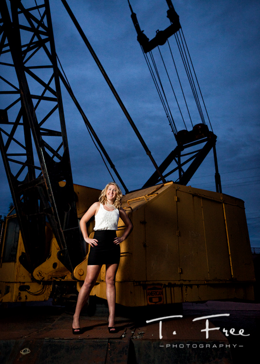 Very unique senior girl on a crane picture taken in Omaha.