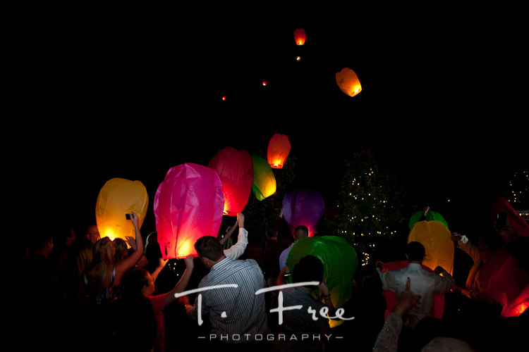 Lighting and releasing the Chinese lanterns at the wedding reception.