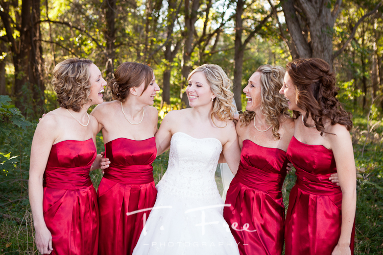 Bridesmaids having fun during their photo shoot before the reception in Omaha.