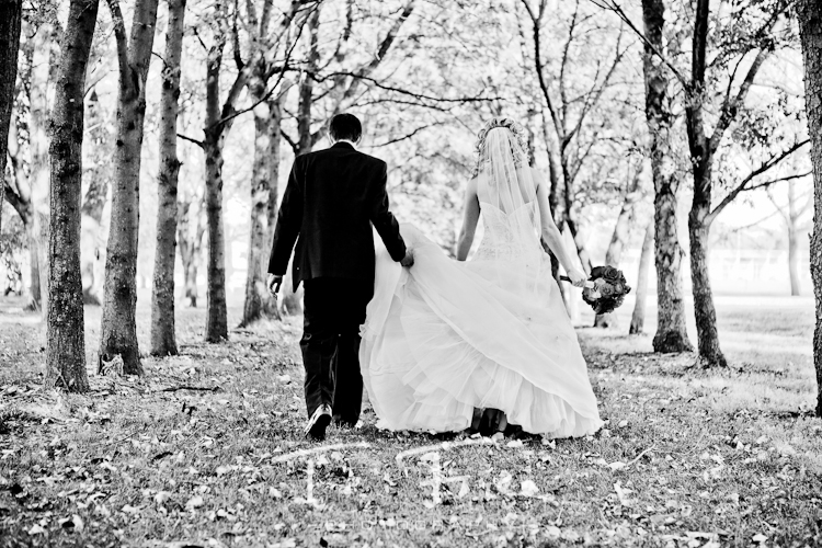Bride and groom in a truly amazing black and white image taken at Seymour Smith Park in Omaha Nebraska.