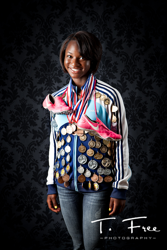 Phenomenal high school track star medal jacket Brownell-Talbot senior portrait Omaha.