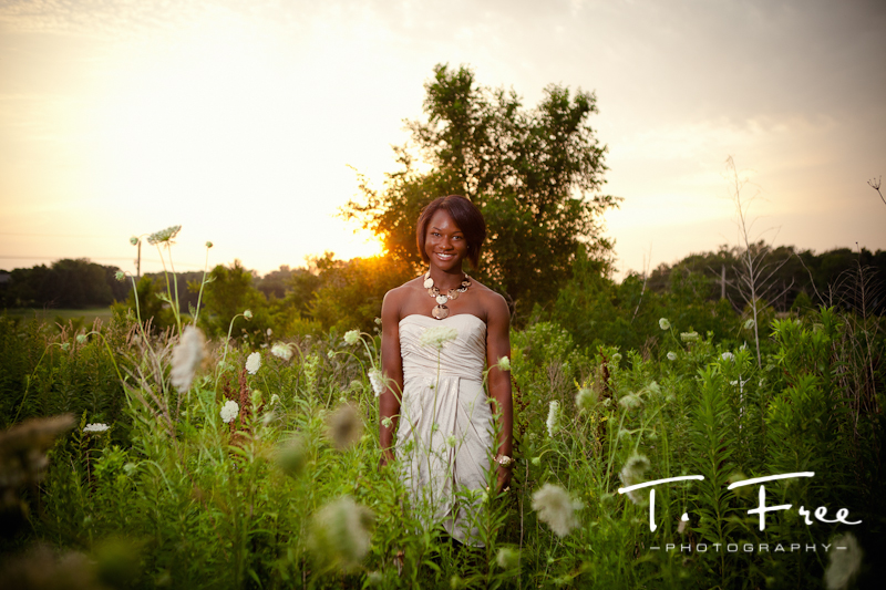 Tall grass field at sunset outdoor Brownell-Talbot senior portrait in downtown Omaha.