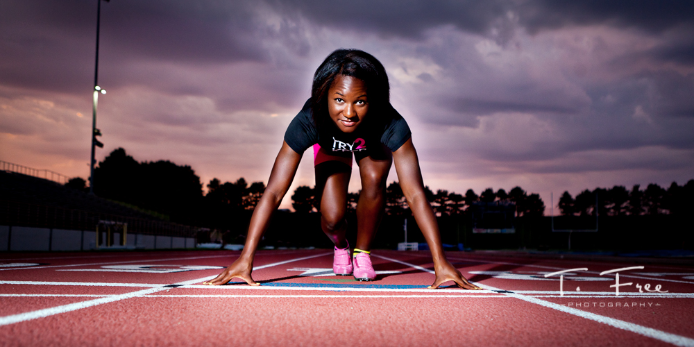 Creative award winning high school senior track portrait taken at Burke Stadium Omaha Nebraska.