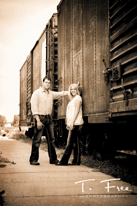 Cool sepia engagement image along old rail car in Hooer Nebraska.