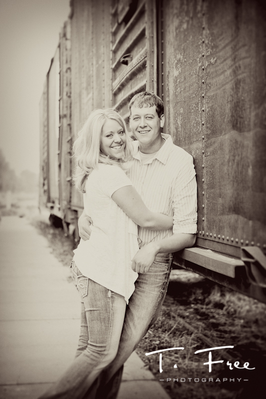 Old school style outdoor engagement picture by an old train near downtown Hooper Nebraska.