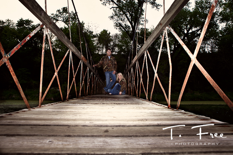 Outdoor engagment couple with camo shirts at Dead Timber State Recreation Area Nebraska.