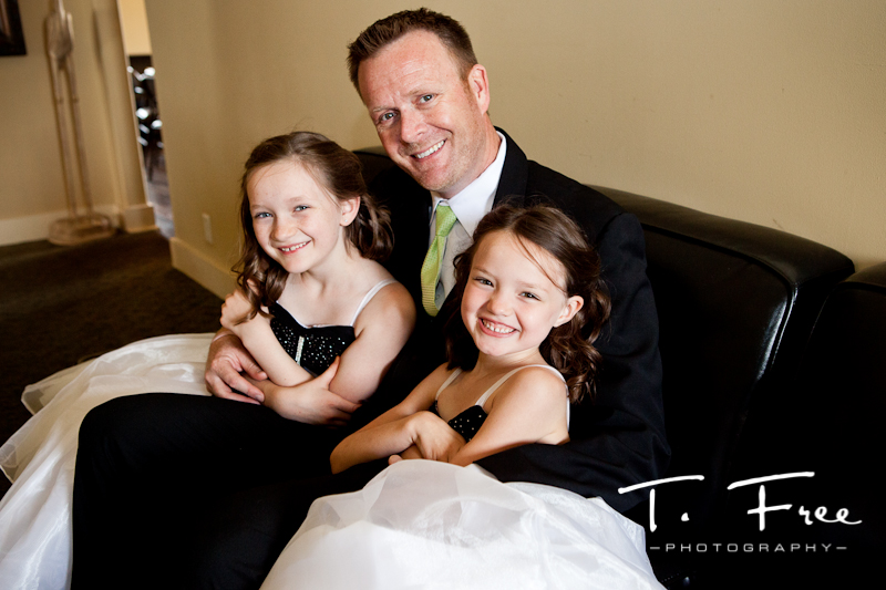 Dad enjoying time with his daughters before the wedding ceremony.