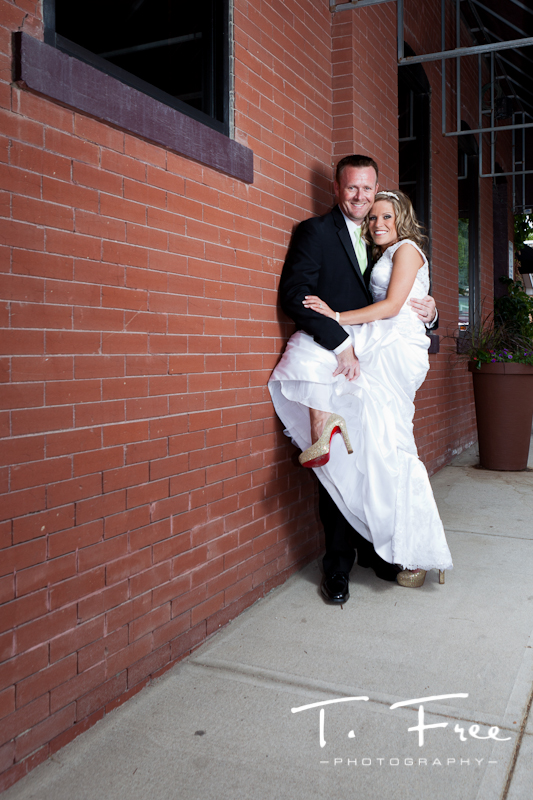 Fun photo shoot with the bride and groom after outdoor wedding in downtown Elkhorn Nebraska.