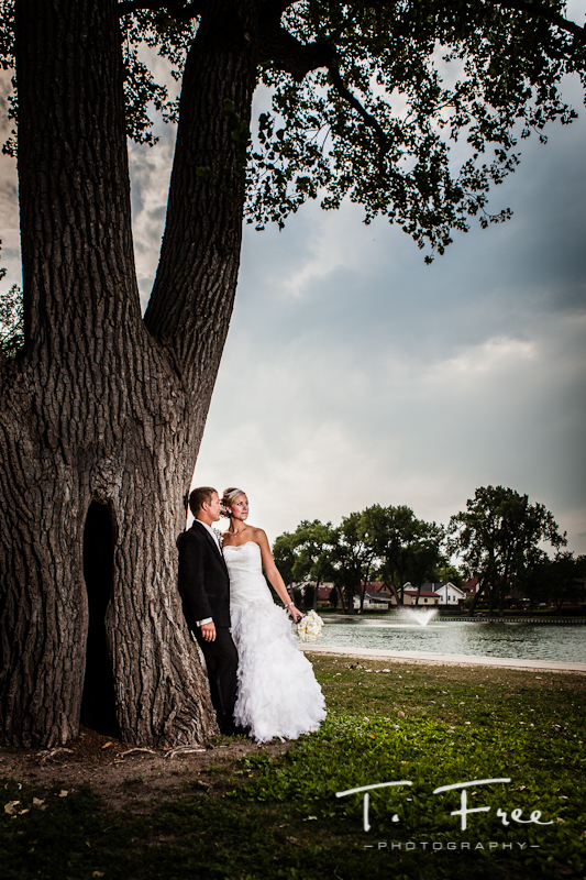 Creative outdoor wedding day image taken at a park in Grand Island Nebraska.