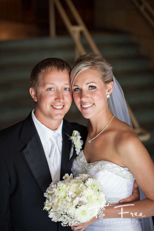 Cool natural light image of the bride and groom prior to ceremony in Grand Island Nebraska.