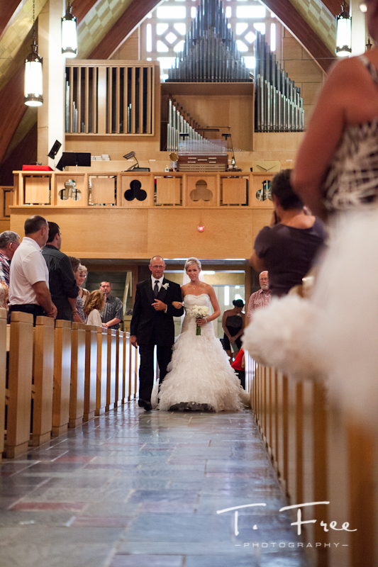 Stunning Grand Island Nebraska bride walking down the aisle with her dad.